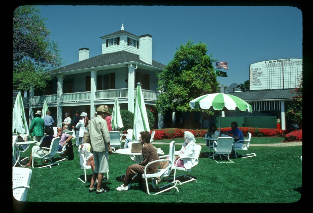 The southern style of the Augusta clubhouse as patrons relax at the 1983 Masters