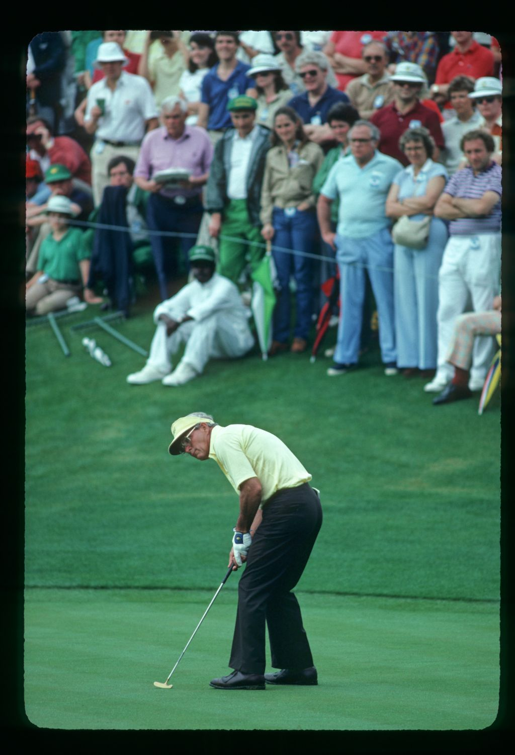 Arnold Palmer putting at the Masters Championship