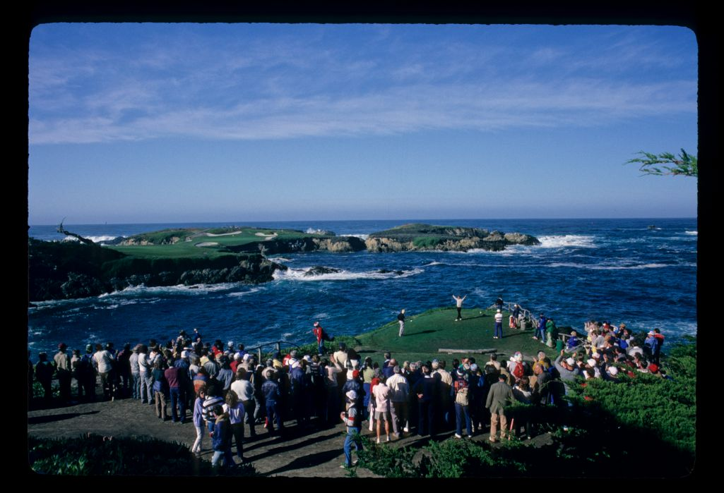 A player celebrates a good tee shot at the 16th hole at Cypress Point during the AT&T Pro-Am