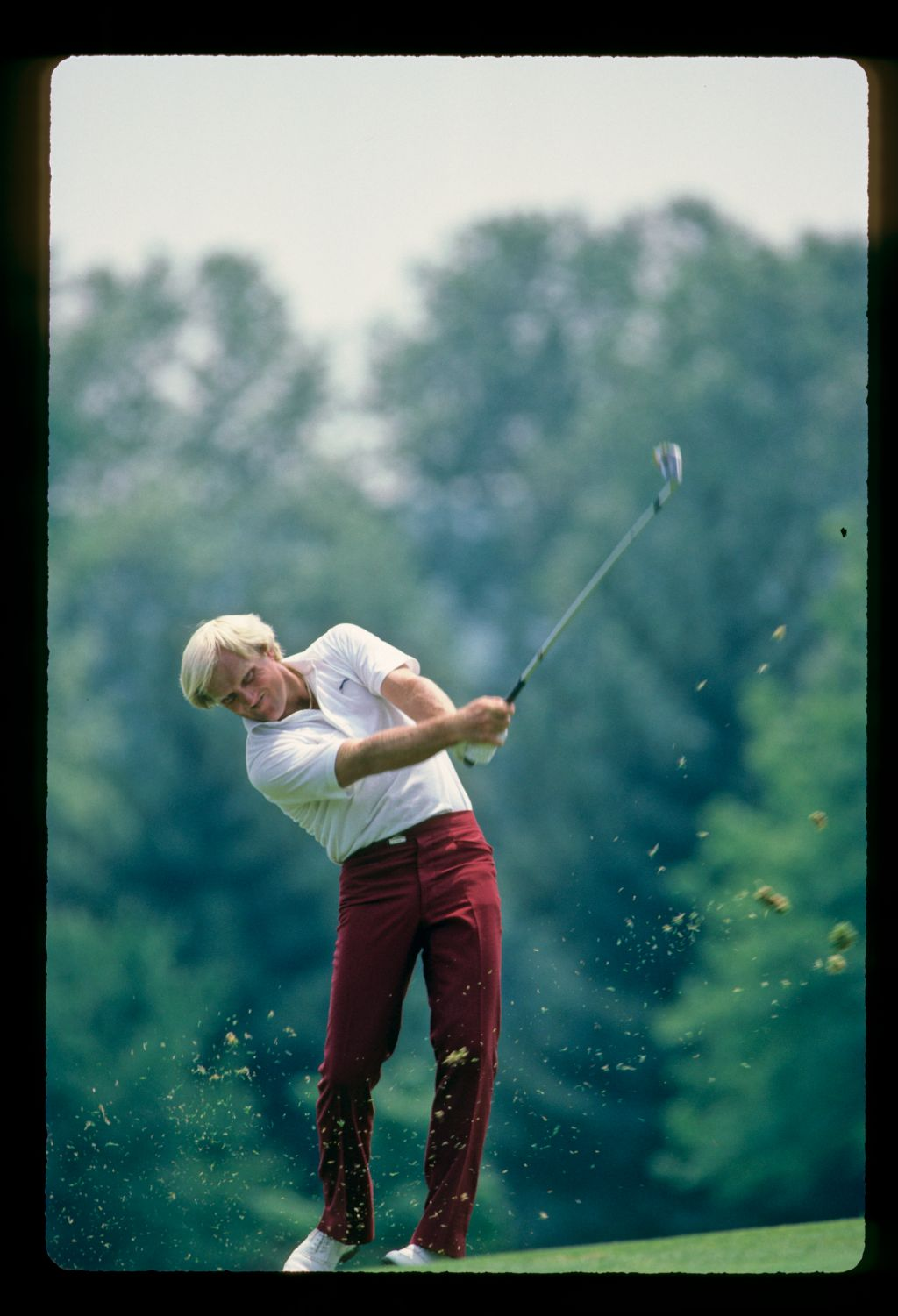 Greg Norman plays his iron shot from the fairway at the U. S. Open Championship