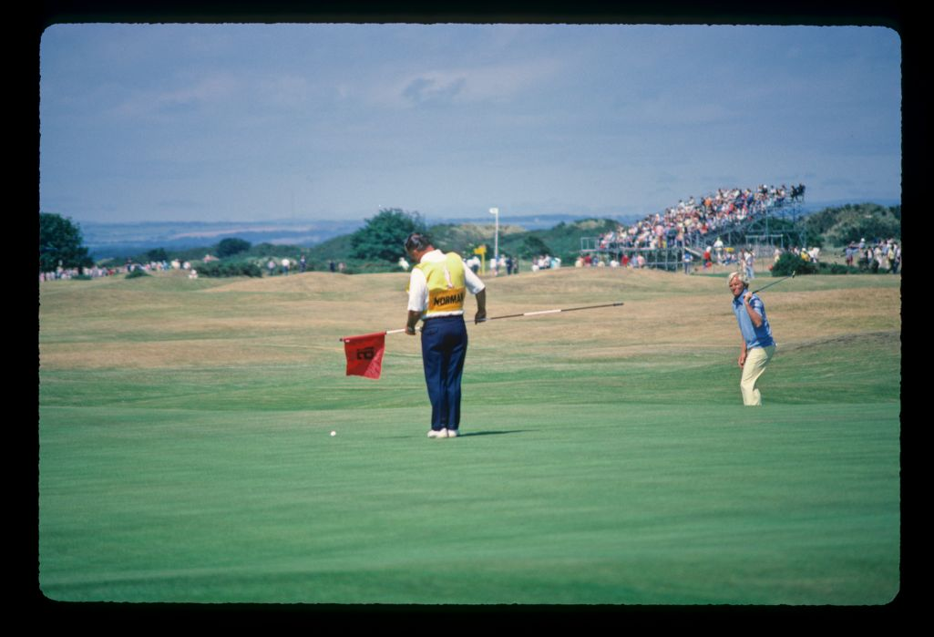 Australian golfer Greg Norman willing his putt to the hole at the 1984 Open Championship at St Andrews