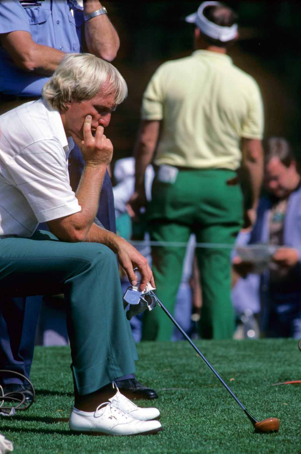 Golfer Greg Norman takes a moment for quiet reflection at the 1985 Masters Championship at Augusta