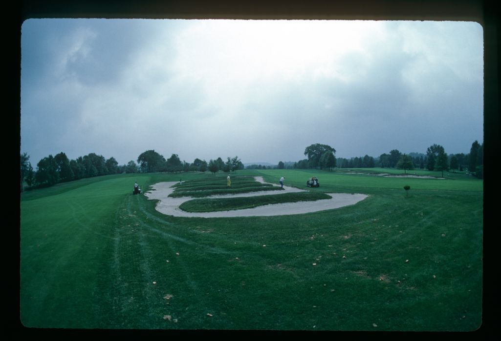 A golfer plays his shot from the famous Church Pews bunkers on the 4th hole at Oakmont Country club