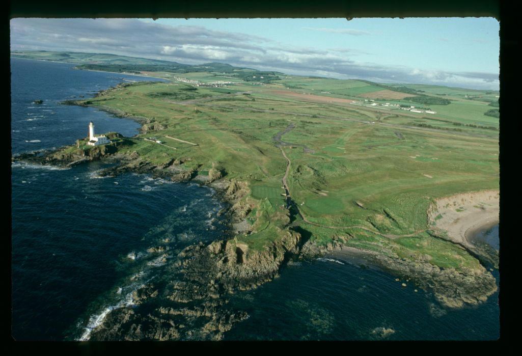 An aerial view of the Ailsa Golf Course and Lighthouse at Turnberry