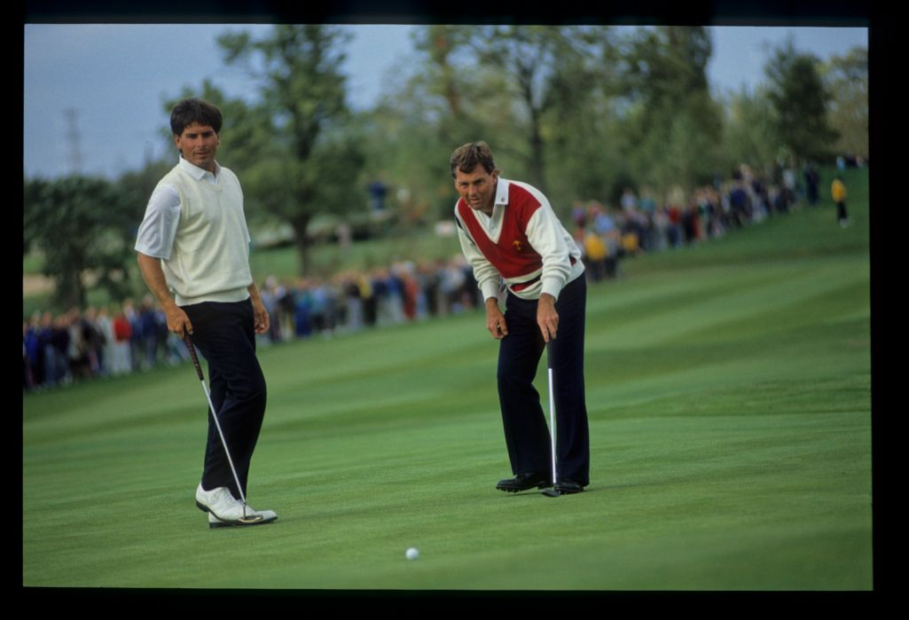 American teammates Freddy Couples and Lanny Wadkins survey the putt at the 1989 Ryder Cup