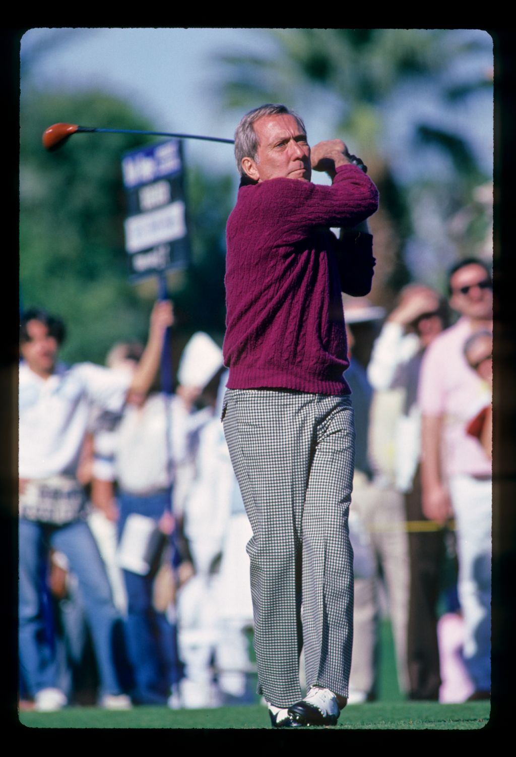 Singer Andy Williams tees off at the 1982 Bob Hope Desert Classic Golf Championship