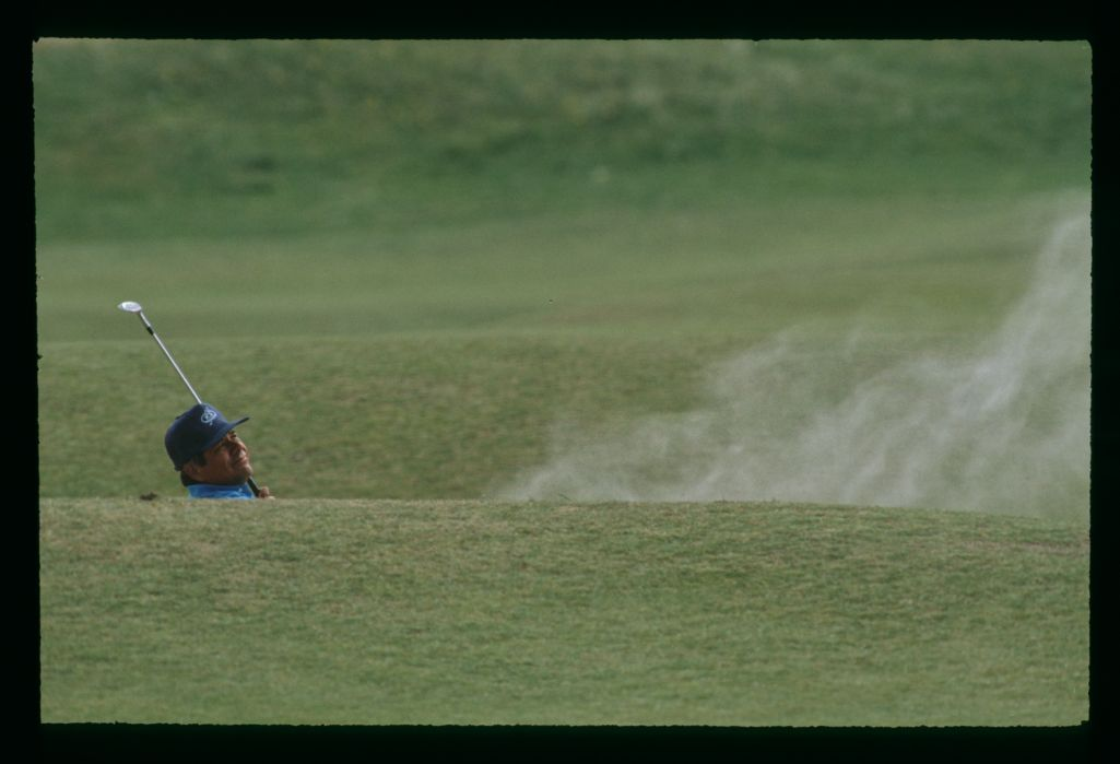 Lee Trevino is barely visible in a bunker during the 1993 Open Championship