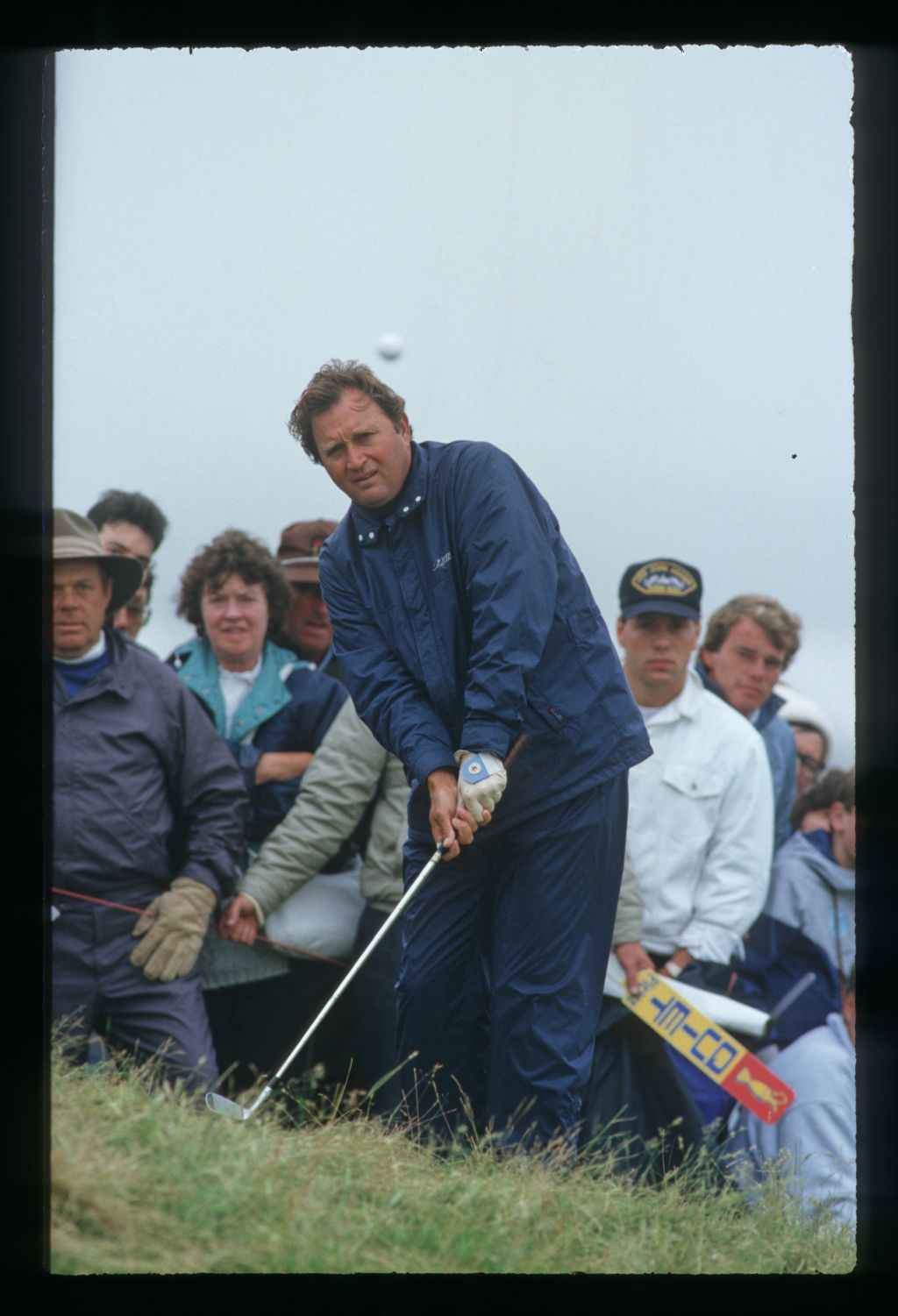 American golfer Ray Floyd plays from the rough in rainy weather at the 1987 Open Championship at Muirfield