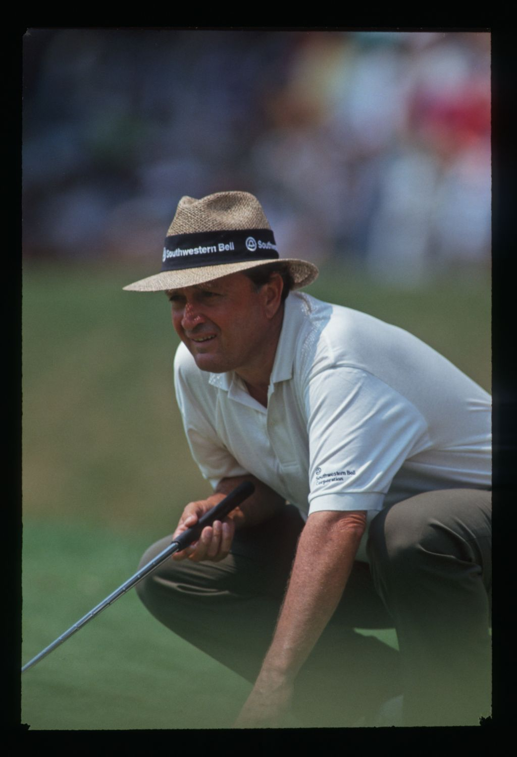 Golfer Ray Floyd concentrates on the line of his putt at the 1993 United States Open Championship