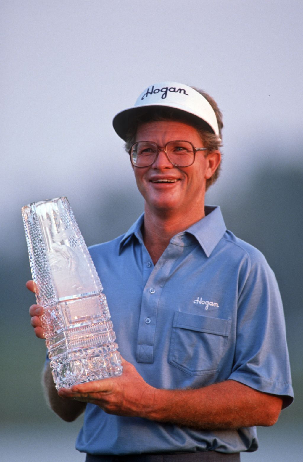Tom Kite is all smiles as he lifts the 1989 Players Championship trophy