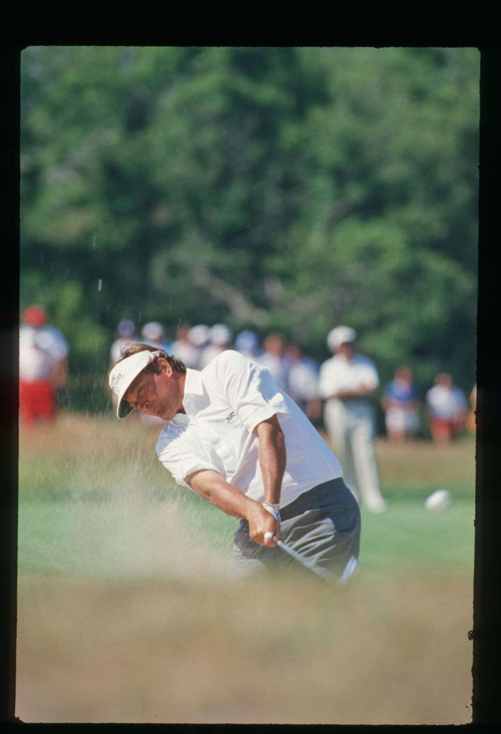 Golfer Ray Floyd blasts his ball out of the bunker at the 1986 United States Open Championship
