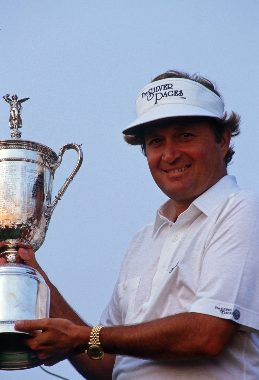 Golfer Ray Floyd lifts the winner's trophy at the 1986 United States Open Championshp