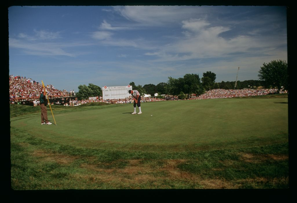 Payne Stewart watches as his putt goes into the hole for the playoff win at the 1991 United States Open Championship