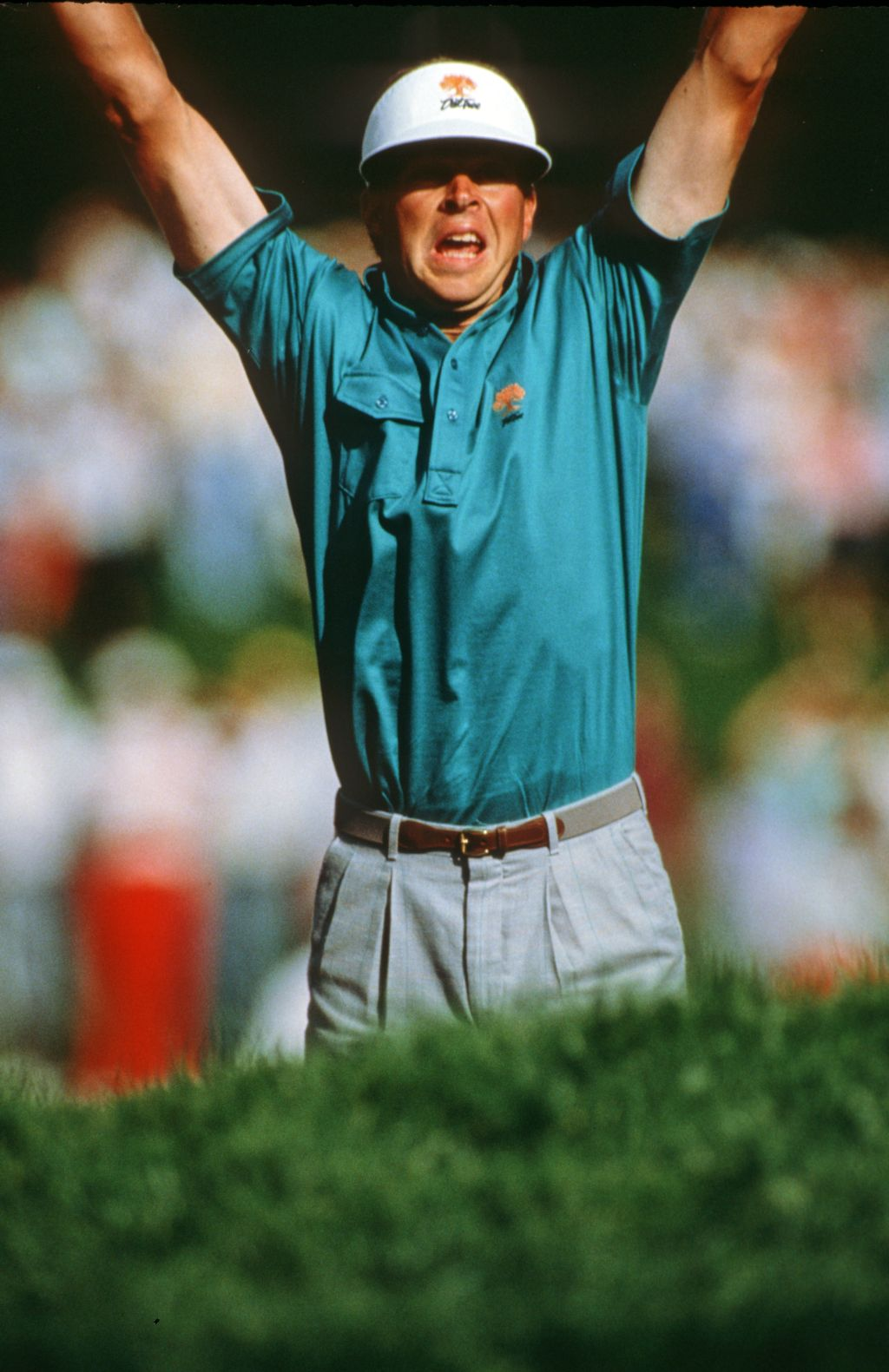 A jubilant Bob Tway leaps into the air as he holes his bunker shot on the 18th green to win the 1986 USPGA