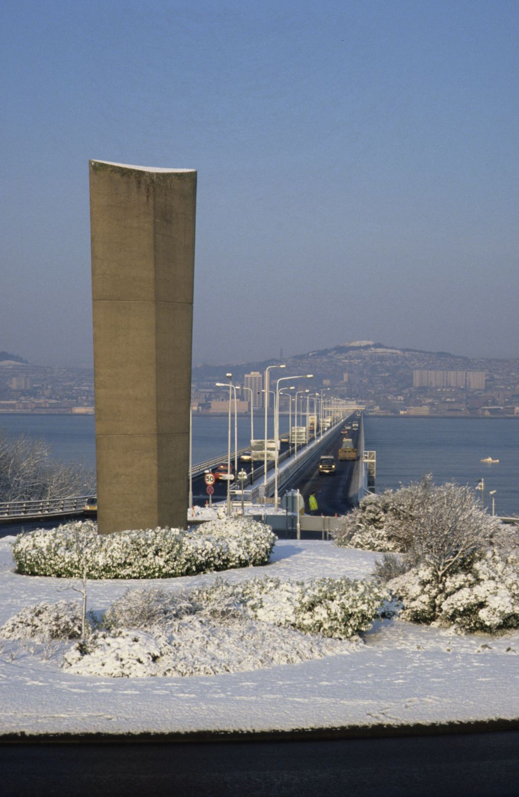 A winter view of the Tay Road Bridge and monument.