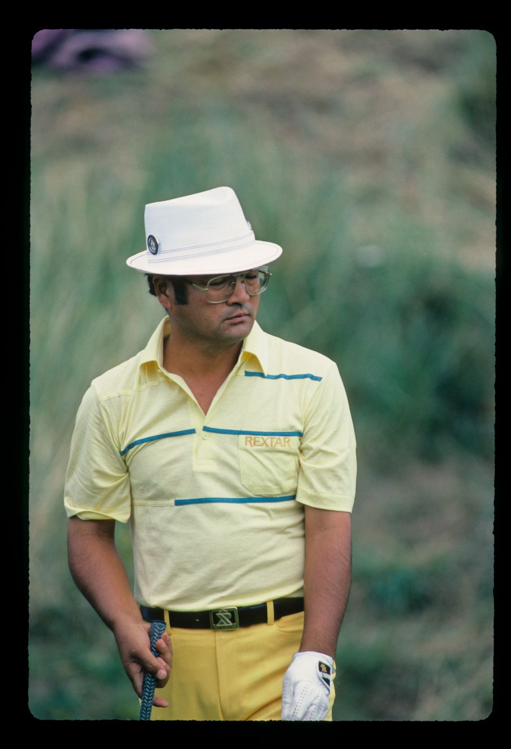 Kikuo Arai closely watches his putt at the 1984 Open Championship