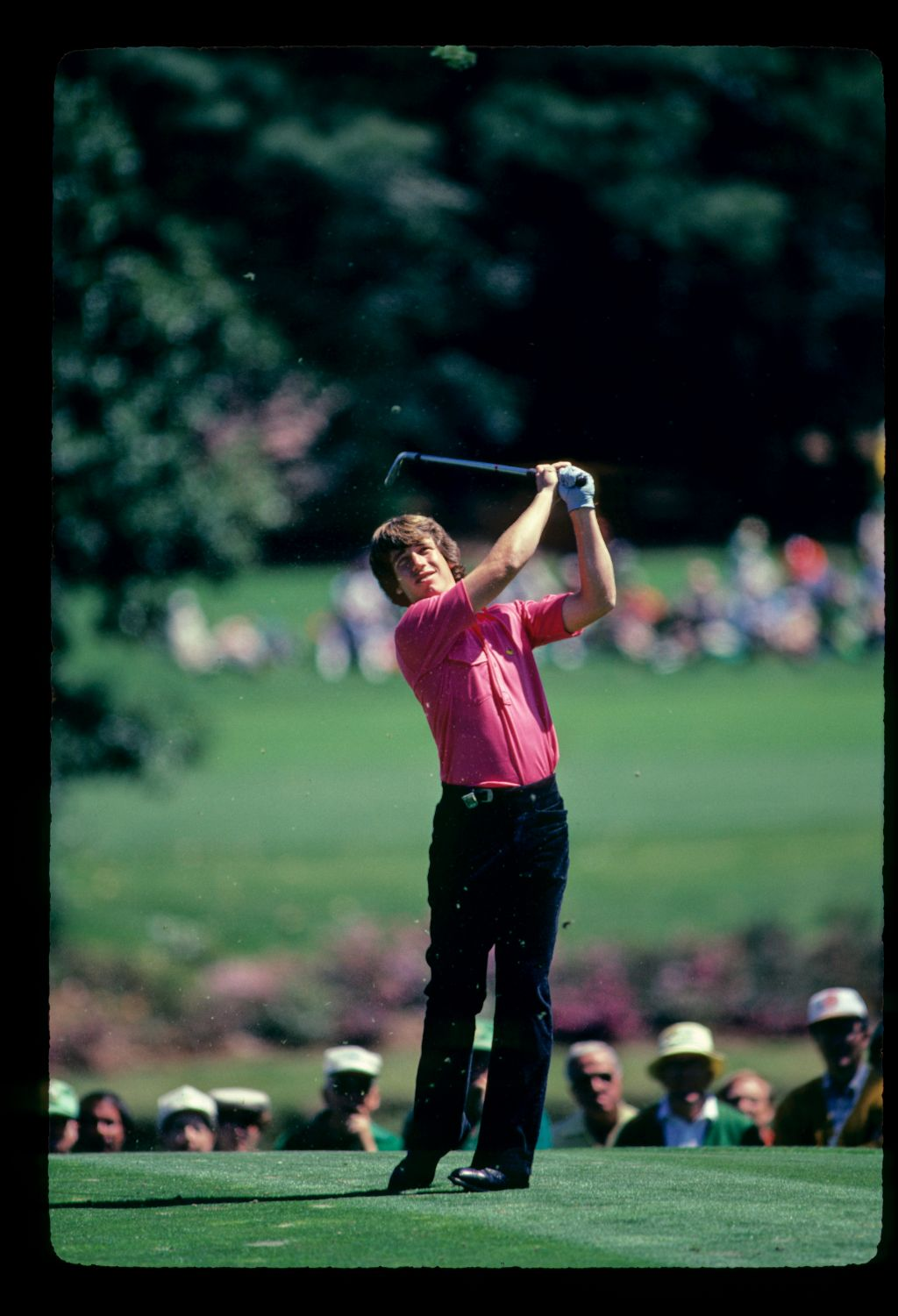 Nathaniel Crosby takes a huge divot with his short-iron tee shot at the 1982 Masters