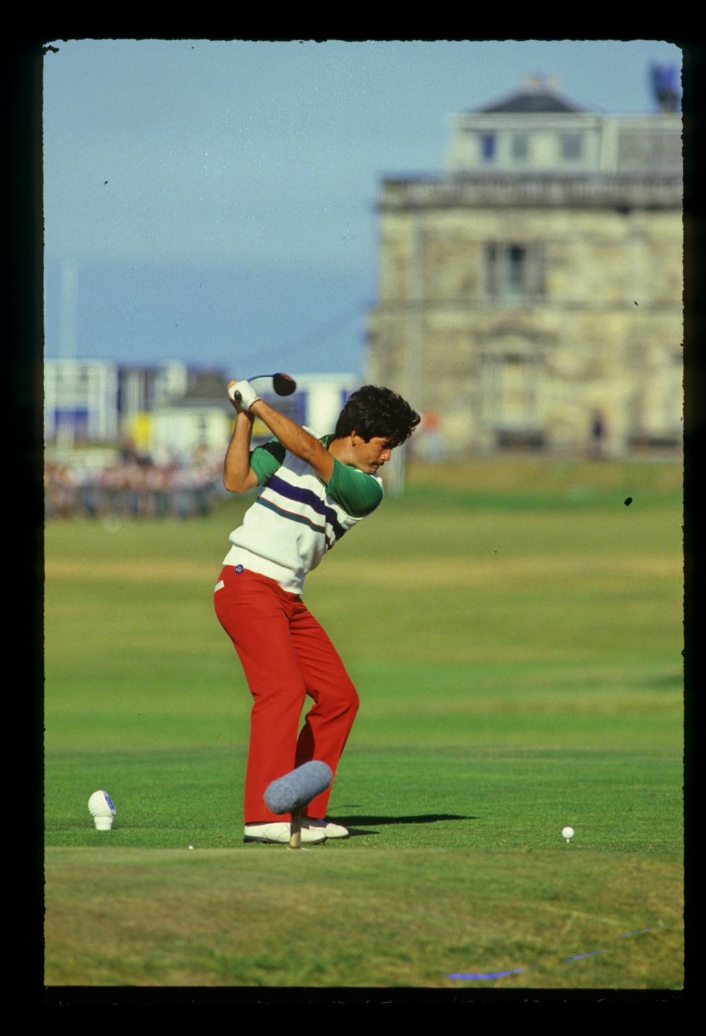 South African golfer David Frost tees off on the 18th of the Old Course at the 1991 Dunhill Cup with the R&A Clubhouse in the background