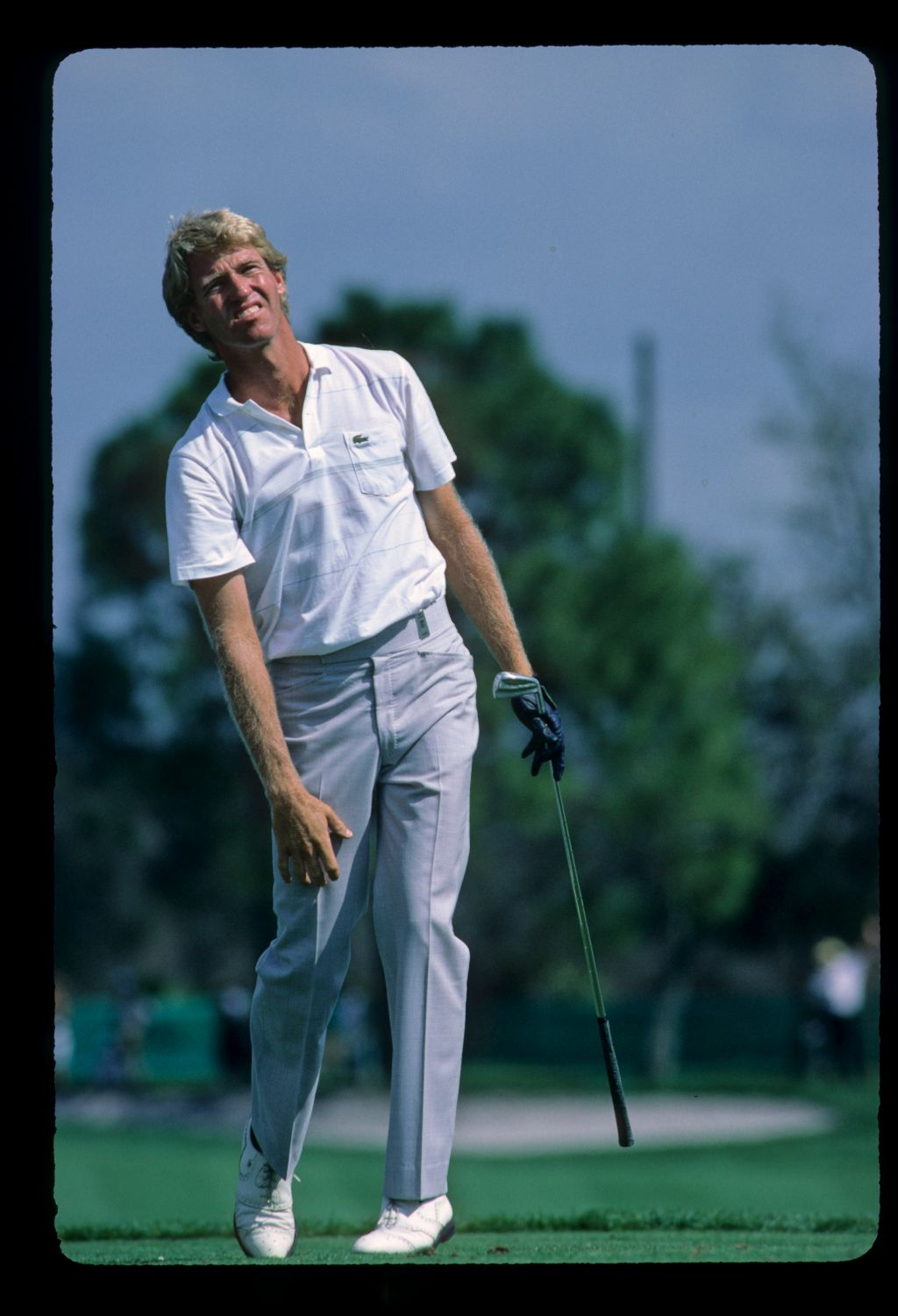American golfer Vance Heafner following his tee shot anxiously at the 1985 Hertz Bay Hill Classic