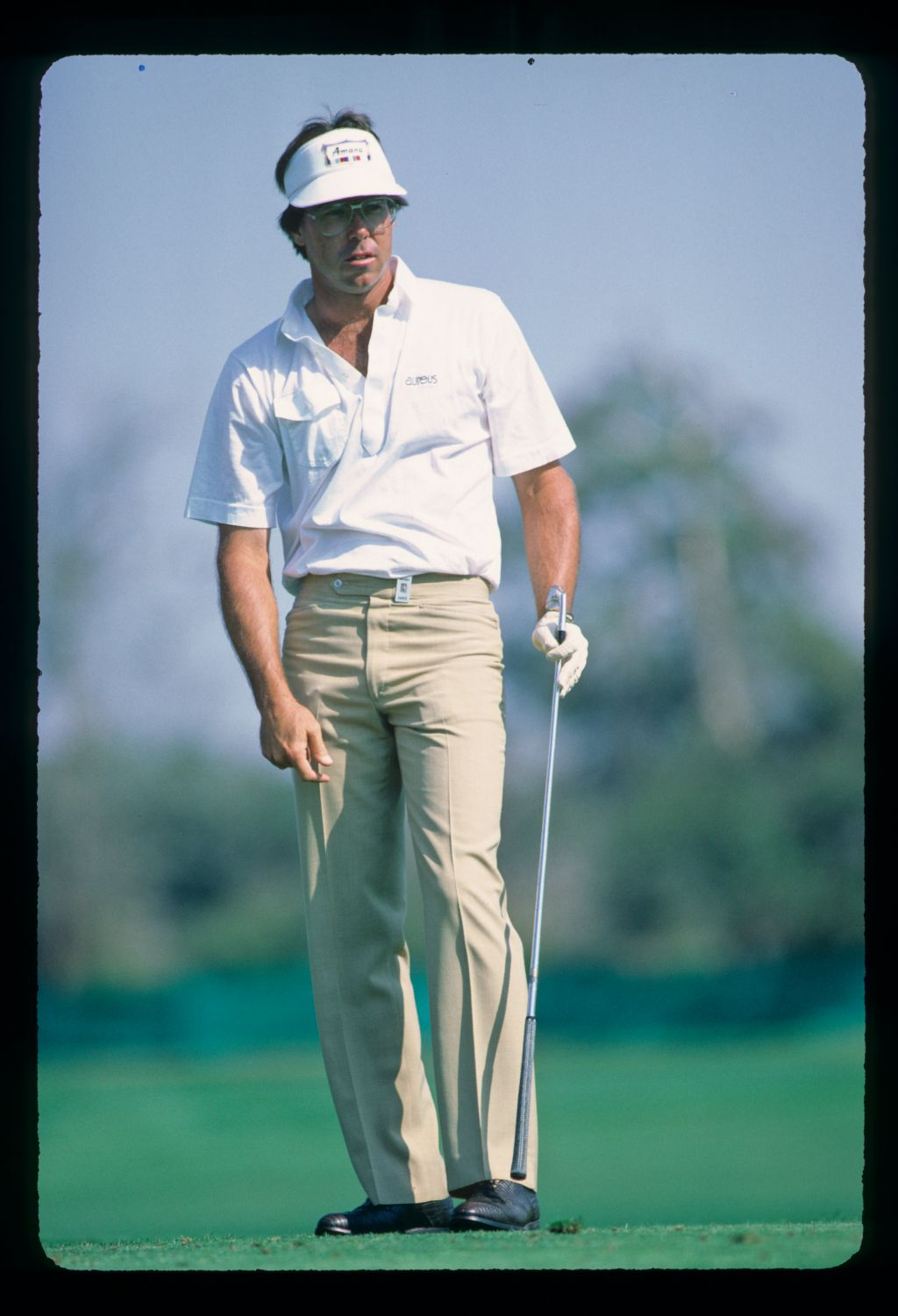 American golfer Bill Kratzert looking concerned after taking a one iron off the tee at the 1985 Hertz Bay Hill Classic