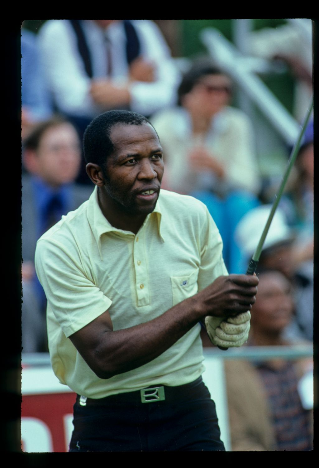 South African golfer Vincent Tshabalala watching anxiously after his drive at the 1980 South African Open