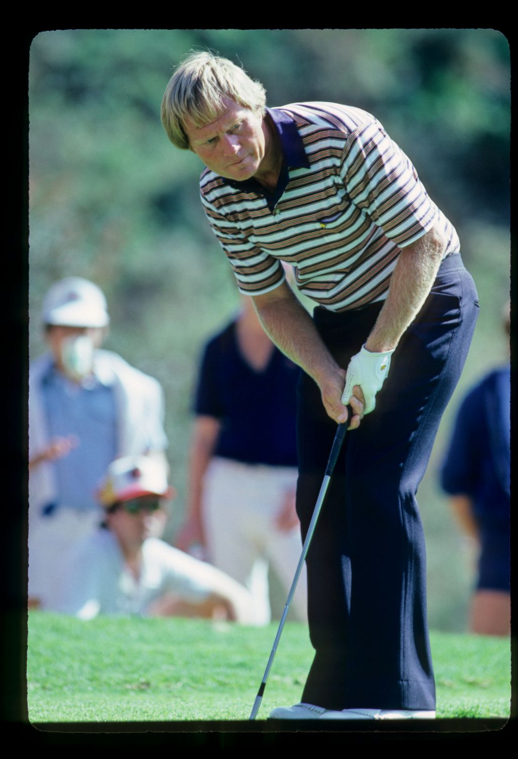 Jack Nicklaus looking intently at the progress of his ball after putting during the 1981 LA Open