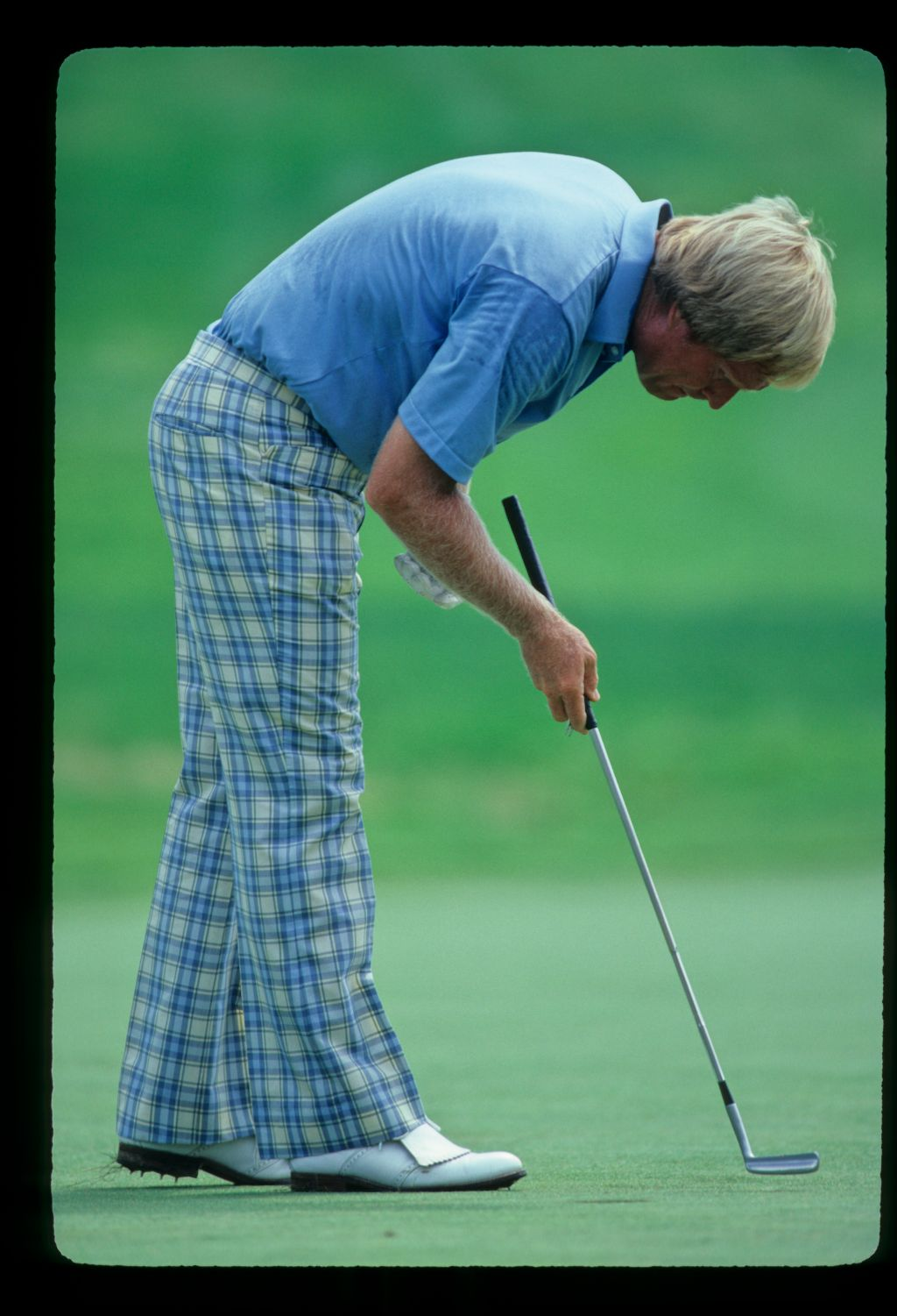 Jack Nicklaus tapping down a blemish on the green during the 1981 US Open