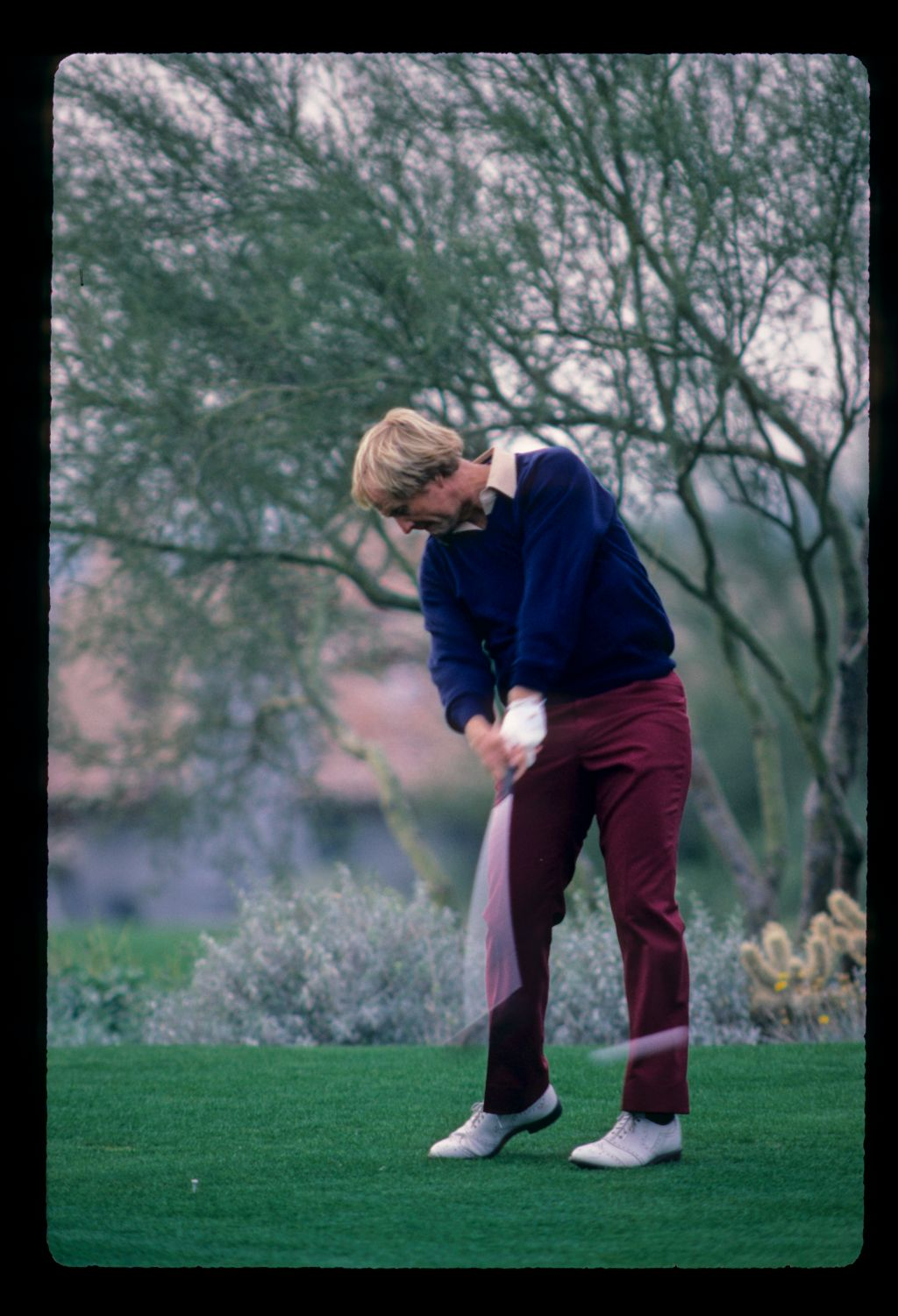 Jack Nicklaus powering through a drive during the 1984 Skins Game