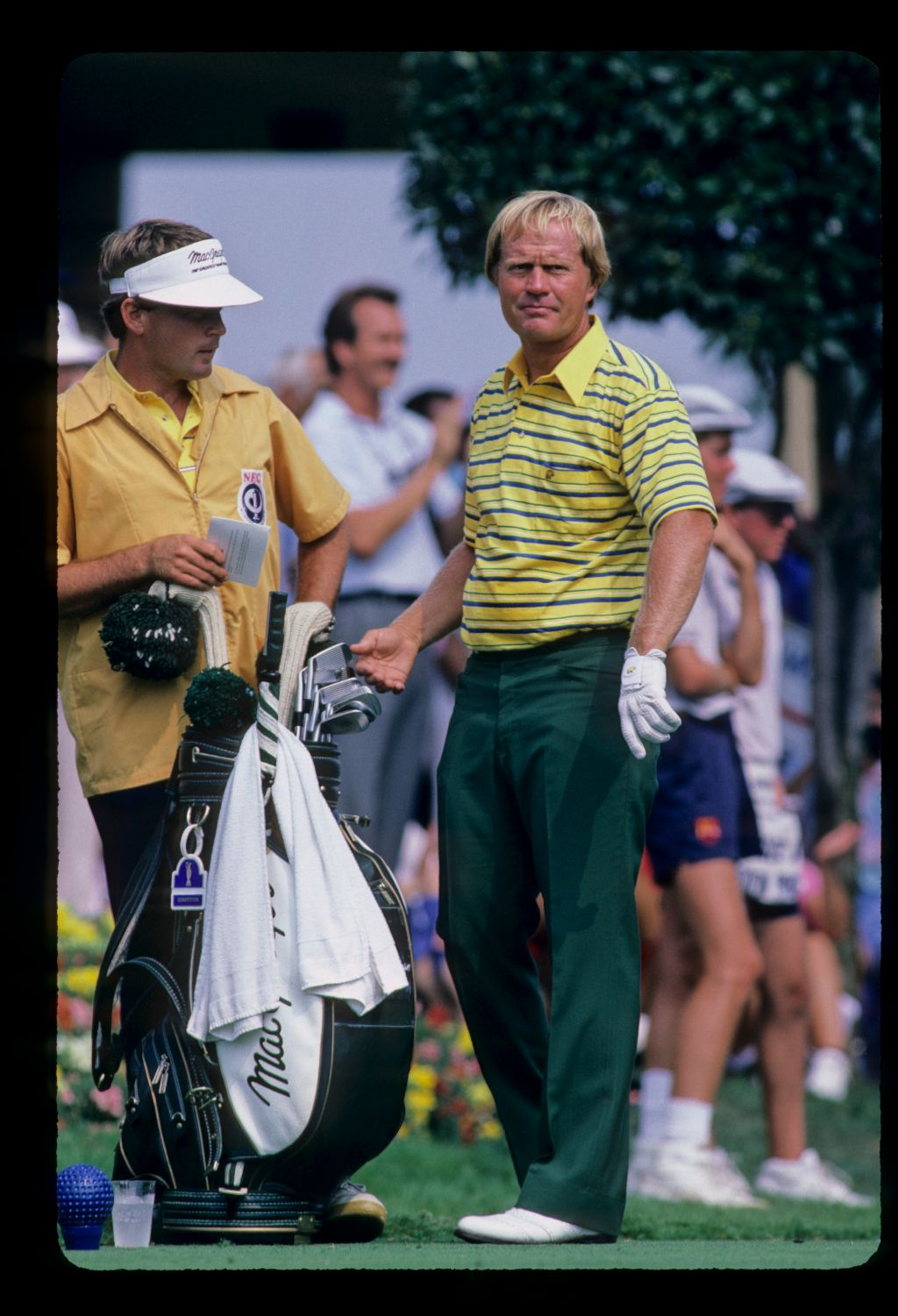 Jack Nicklaus and his caddie making a club selection on the tee during the 1986 World Series of Golf