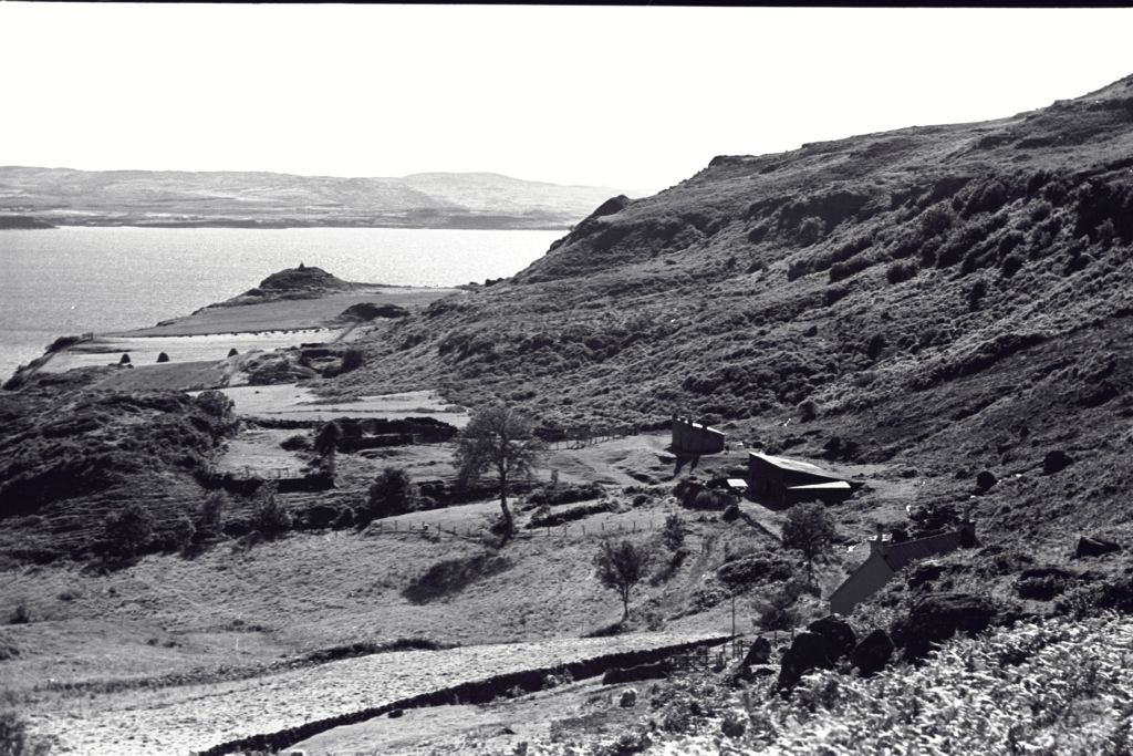 The Burg Farmstead with Dun Bhuirg beyond, Isle of Mull.