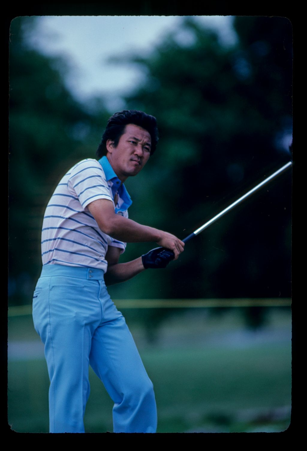 Isao Aoki leaning left after hitting a shot during the 1982 Doral
