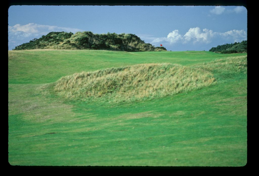 A raised green, thick rough and gorse covered dunes at Royal Troon