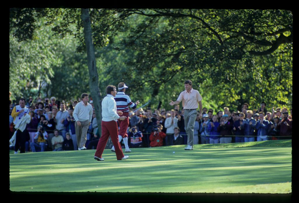 Payne Stewart and Nick Faldo about to shake hands on the 16th green with Ian Woosnam and Lanny Wadkins looking to join in