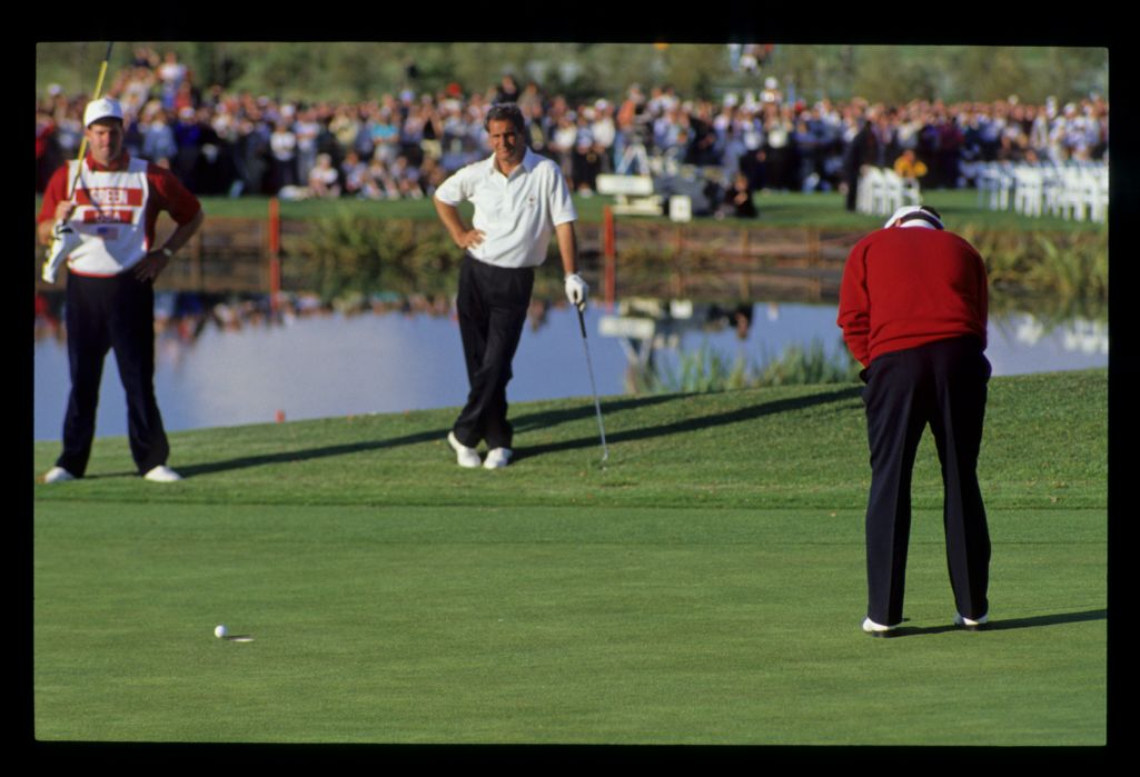 Jose Maria Canizares is relieved as Ken Green's putt slips by the hole on the ninth green during their singles match at the 1989 Ryder Cup