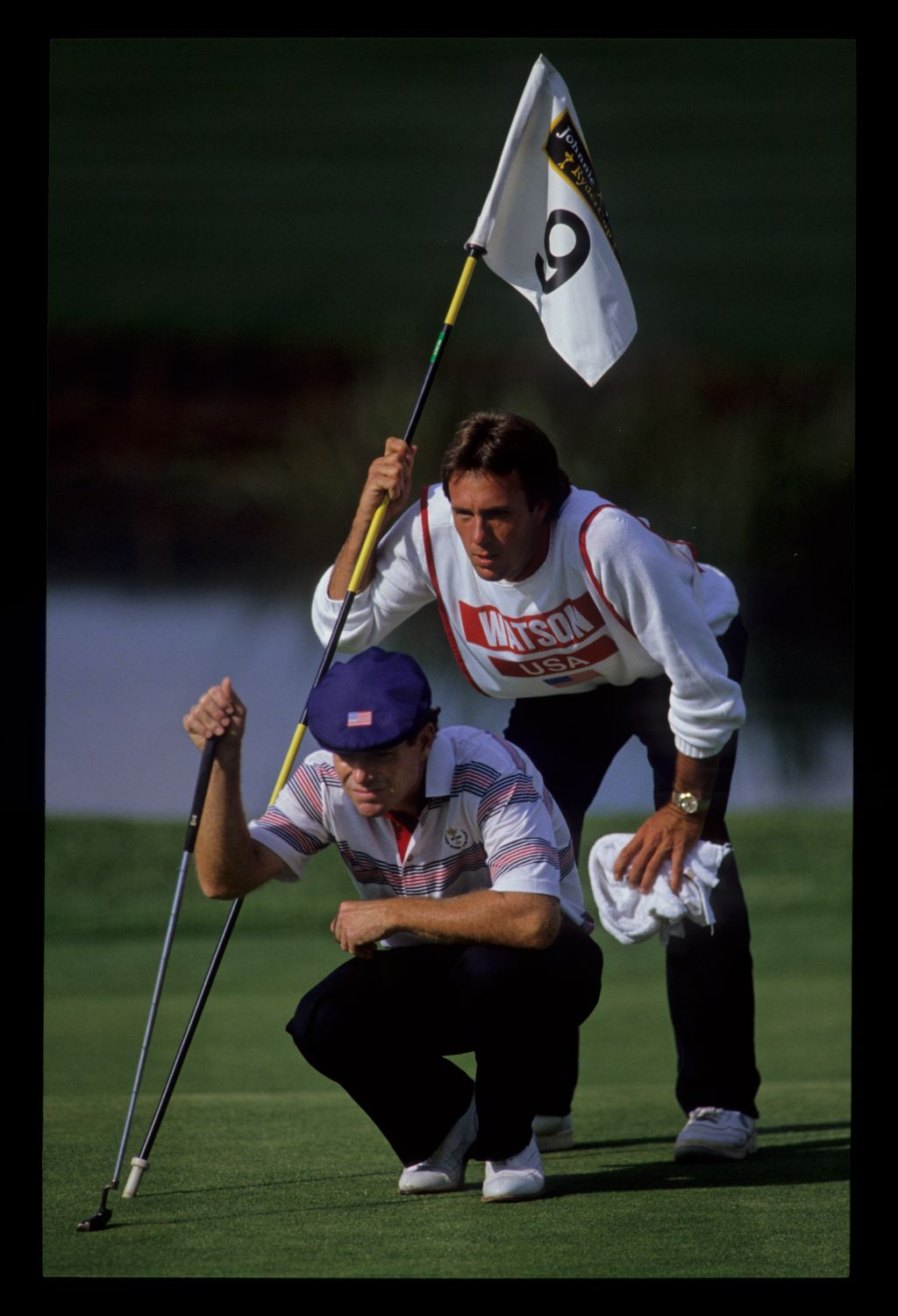 Tom Watson and his caddie staring intently at the line of a putt on the ninth green at the 1989 Ryder Cup
