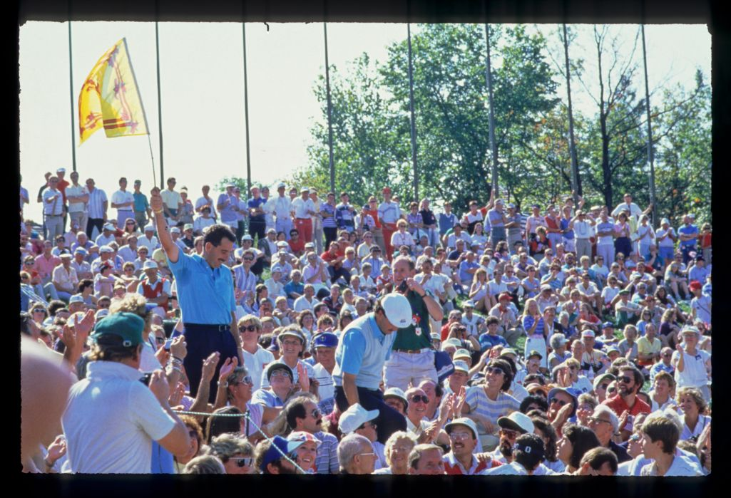 Gordon Brand Jr and Sam Torrance in amongst the spectators with a Scottish Royal Standard after Europe won the 1987 Ryder Cup