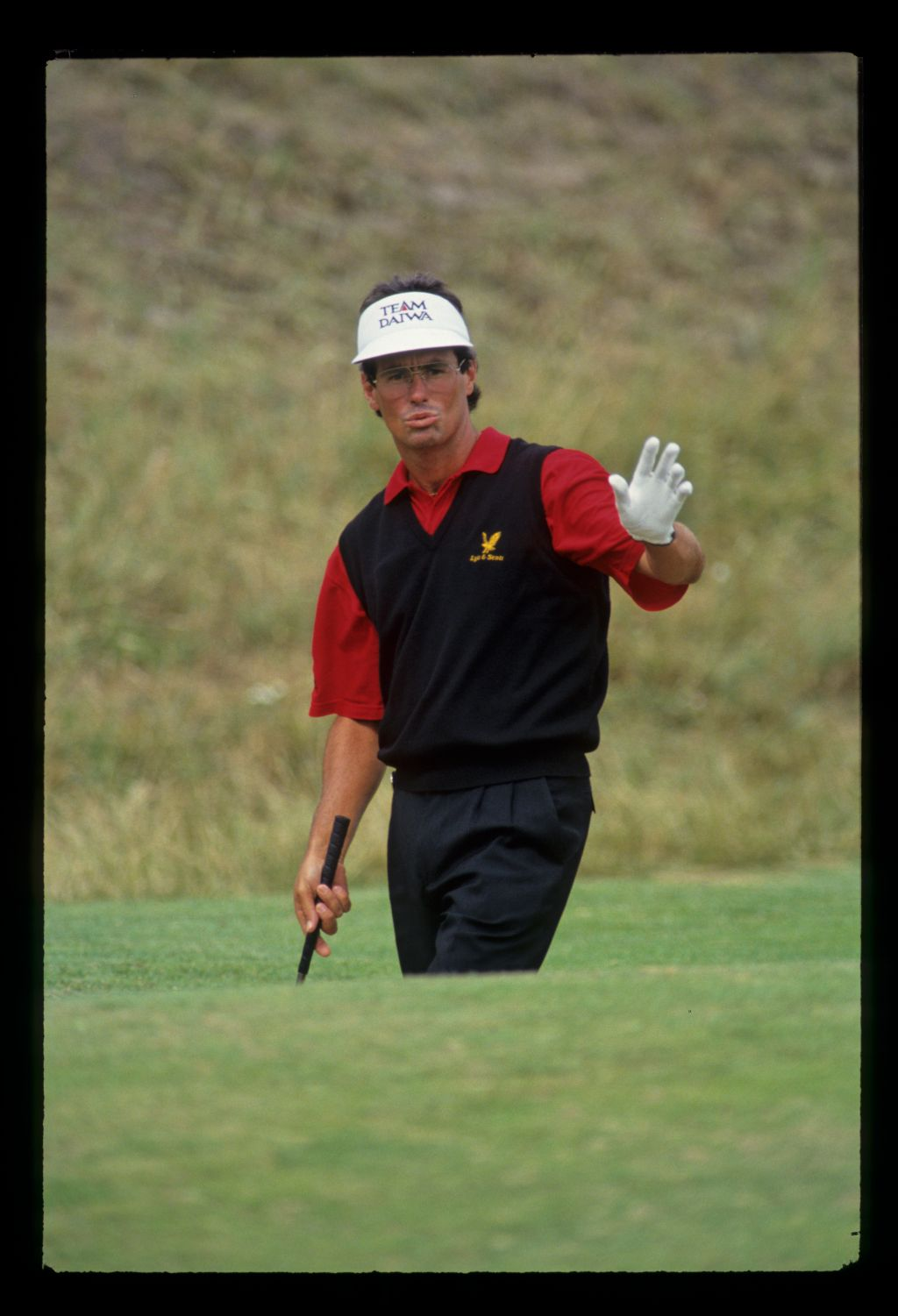Ian Baker Finch pursing his lips and raising his hand in a bunker during the 1993 Open Championship
