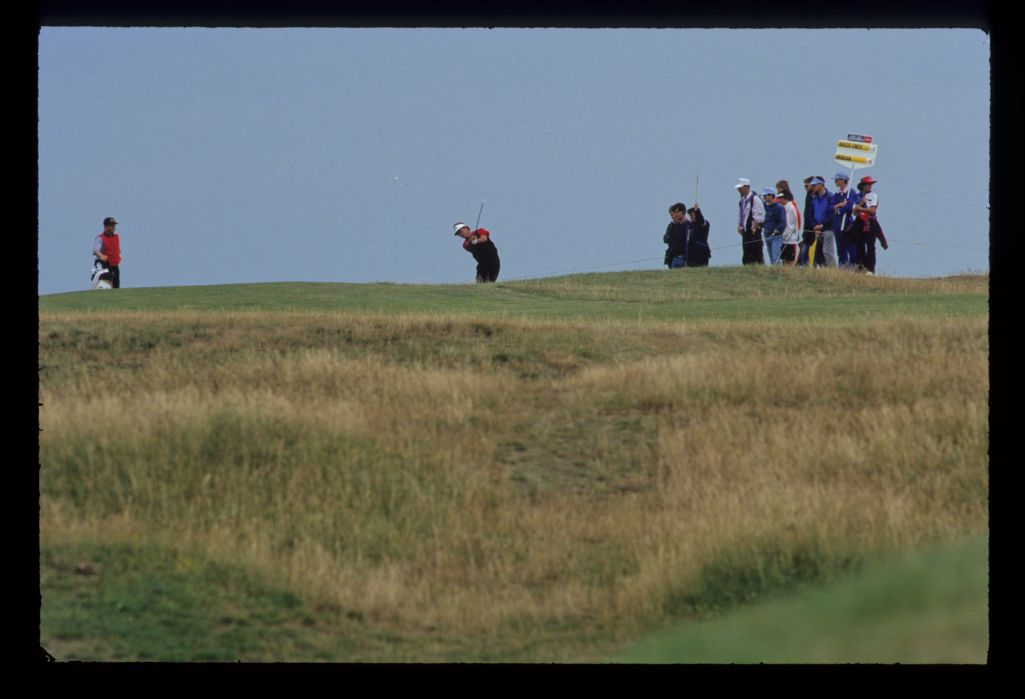 Ian Baker Finch hitting from the top of a hill during the 1993 Open Championship