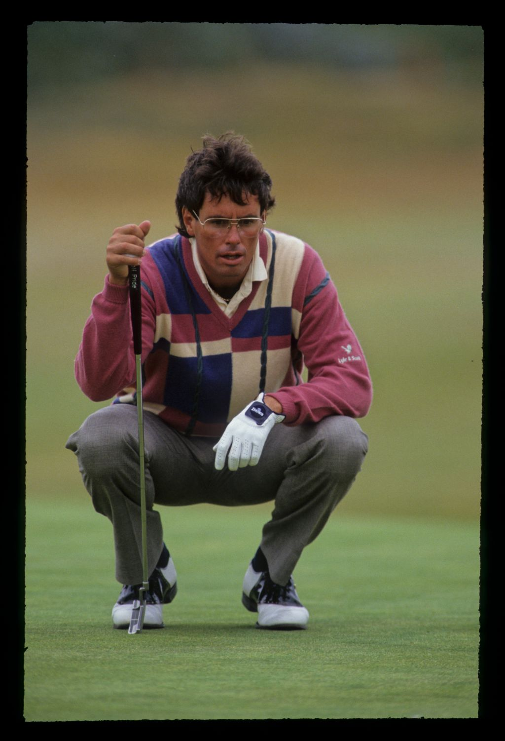Ian Baker Finch squatting to line up a putt on his way to winning the 1991 Open Championship