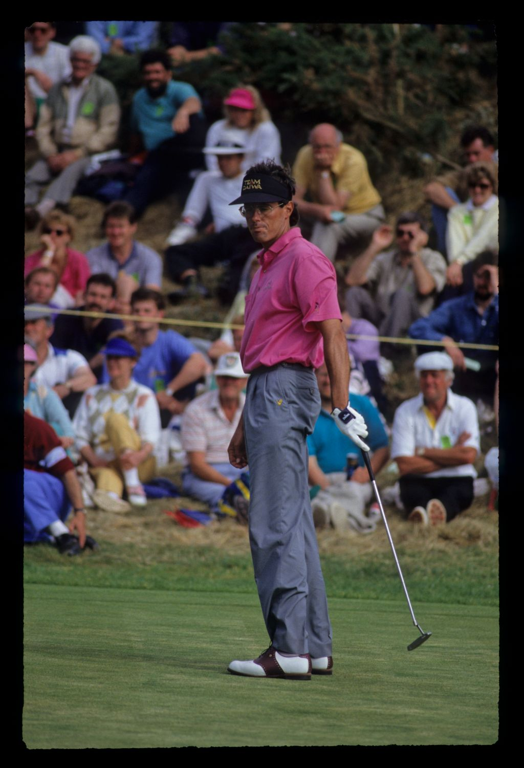 Ian Baker Finch with a sloping putt in front of an Australian flag on his way to winning the 1991 Open Championship