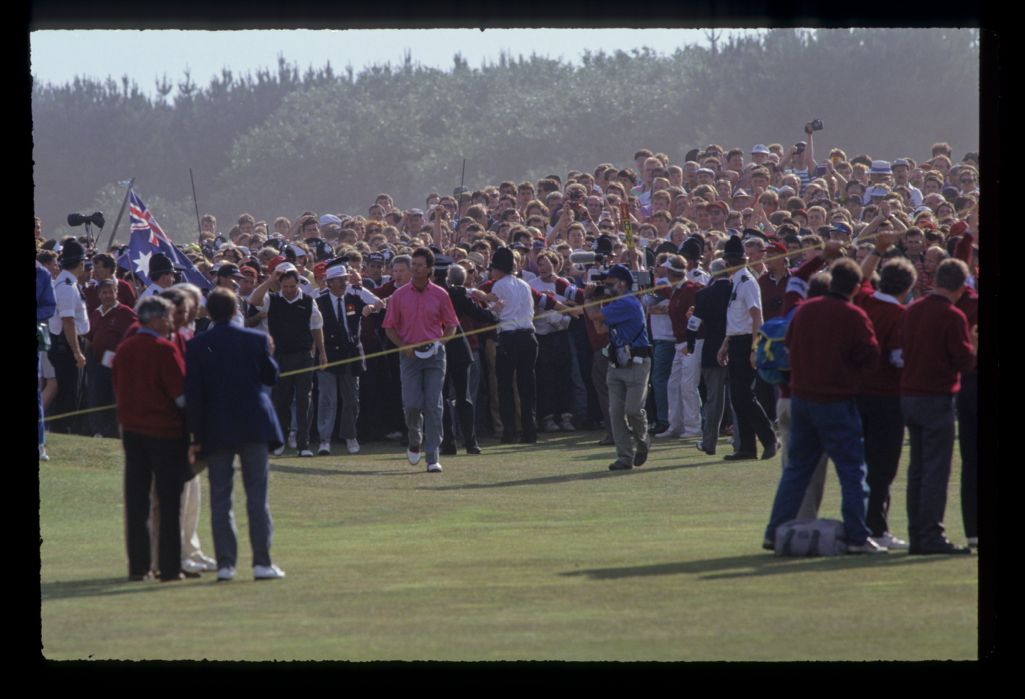 Ian Baker Finch walking up the final fairway with a huge gallery massing behind him on his way to winning the 1991 Open Championship