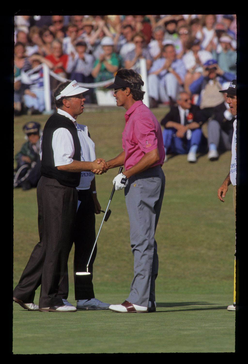 Mark O'Meara congratulating Ian Baker Finch on winning the 1991 Open Championship