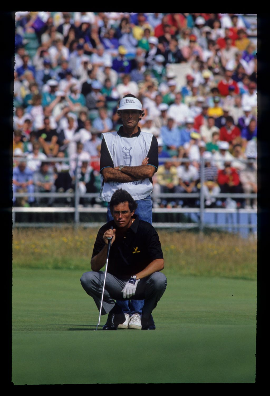 Ian Baker Finch and his caddie lining up a putt during the 1990 Open Championship