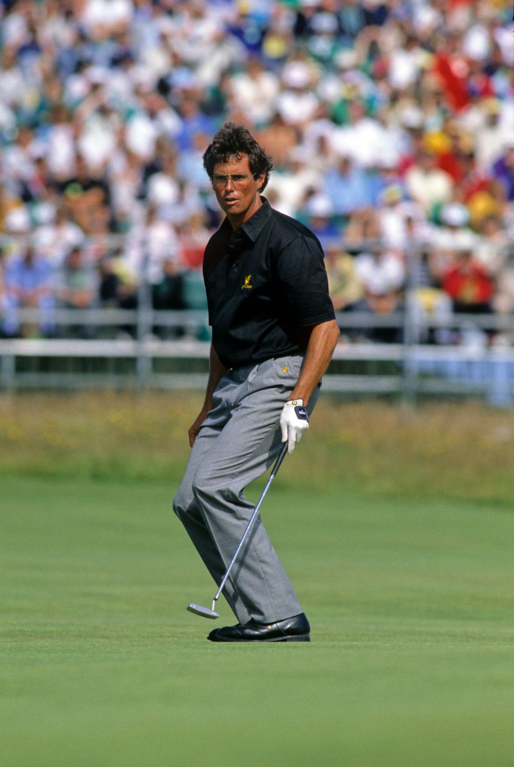 Ian Baker Finch sagging at the knees on the green during the 1990 Open Championship