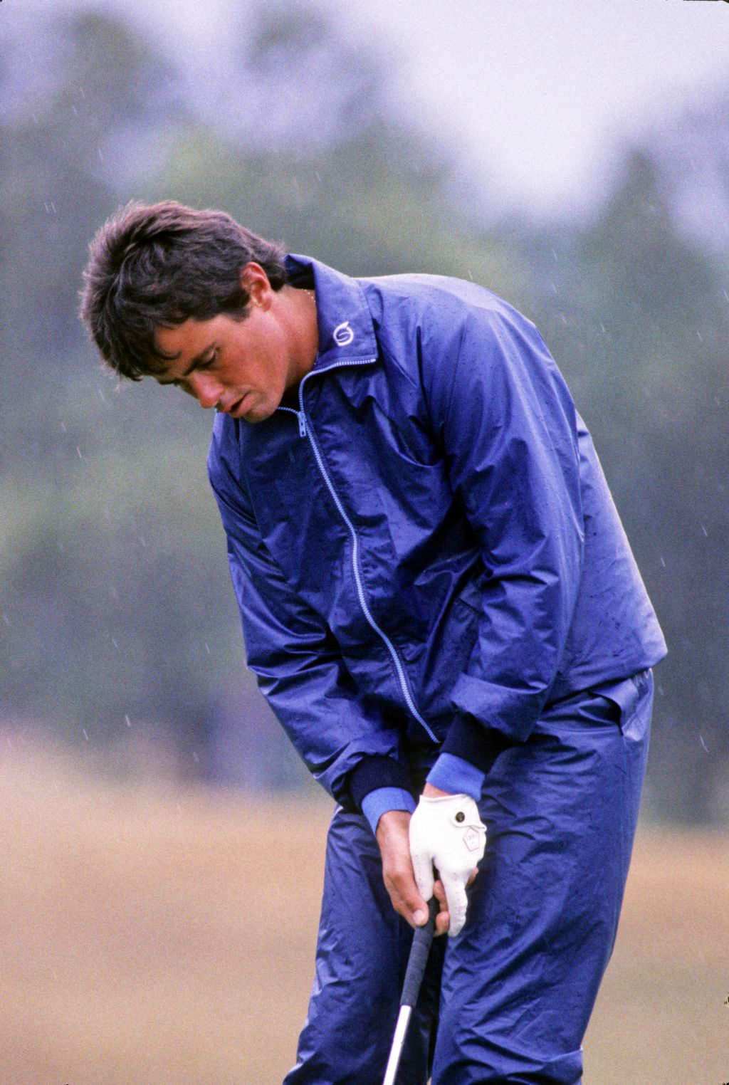 Ian Baker Finch putting in full rain suit on his way to second place at the 1986 Hong Kong Open