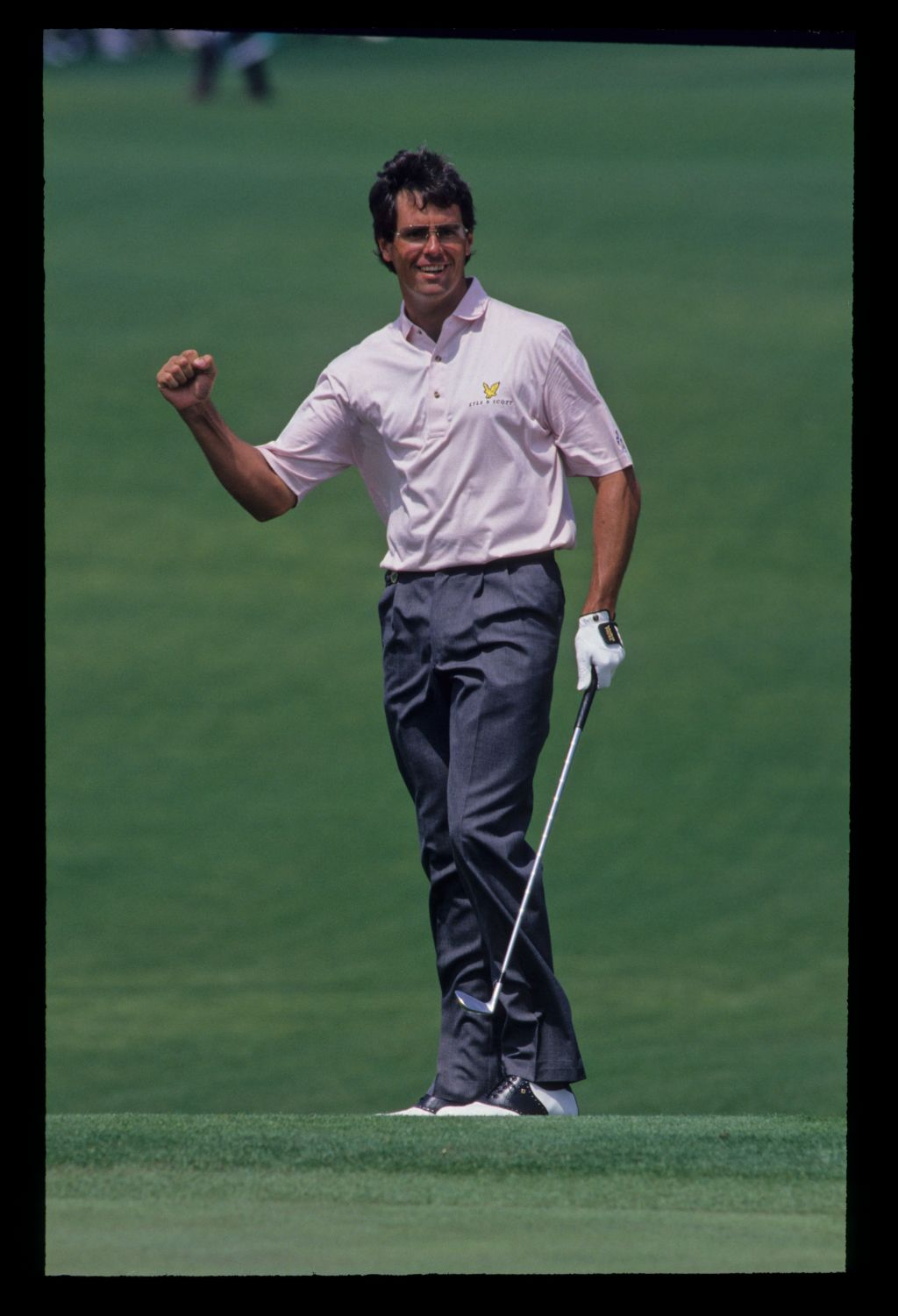 Ian Baker Finch giving a clenched fist salute after chipping in during the 1992 Masters