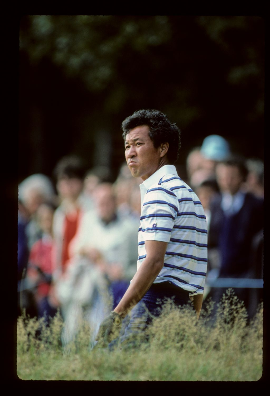 Isao Aoki looking concerned in the rough on his way to winning the 1983 European Open