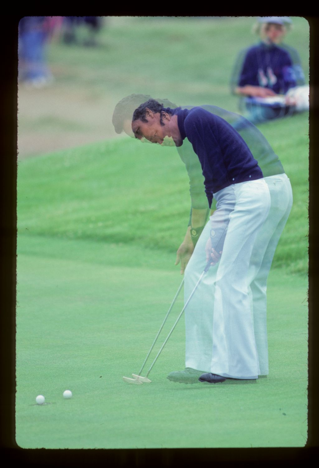 A double exposure of Isao Aoki sinking a putt during the 1980 Open Championship