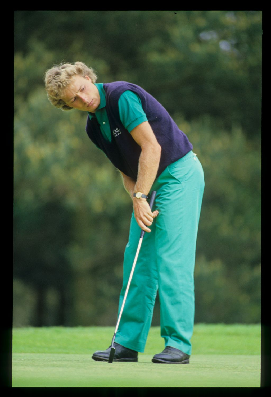 Bernhard Langer watching closely after putting cross handed during the 1986 Dunhill British Masters