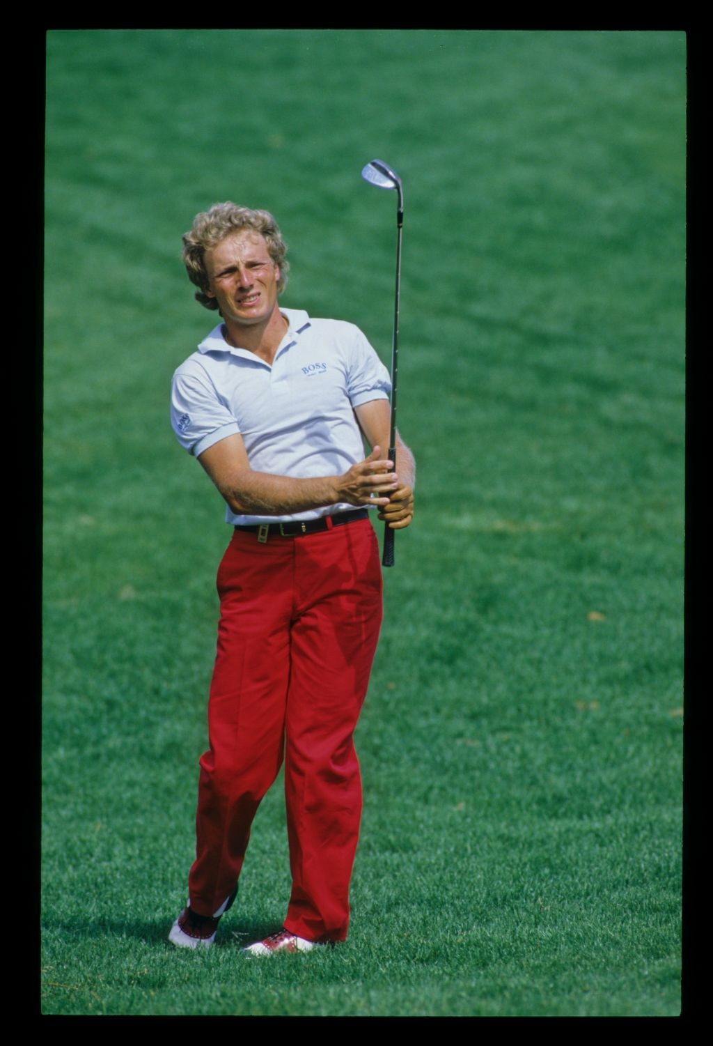 Bernhard Langer letting go of the club after hitting from the rough during the 1986 Hertz Bay Hill Classic